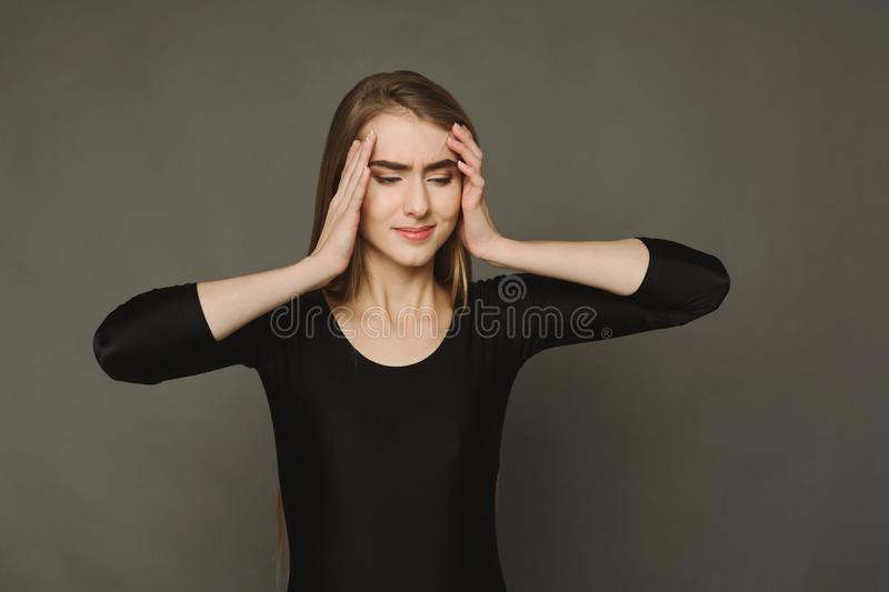 Portrait of young desperate woman with headache stock photography