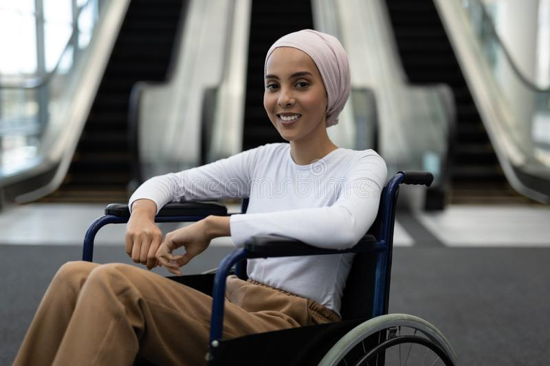 Beautiful disabled female executive in the lobby at office stock photos