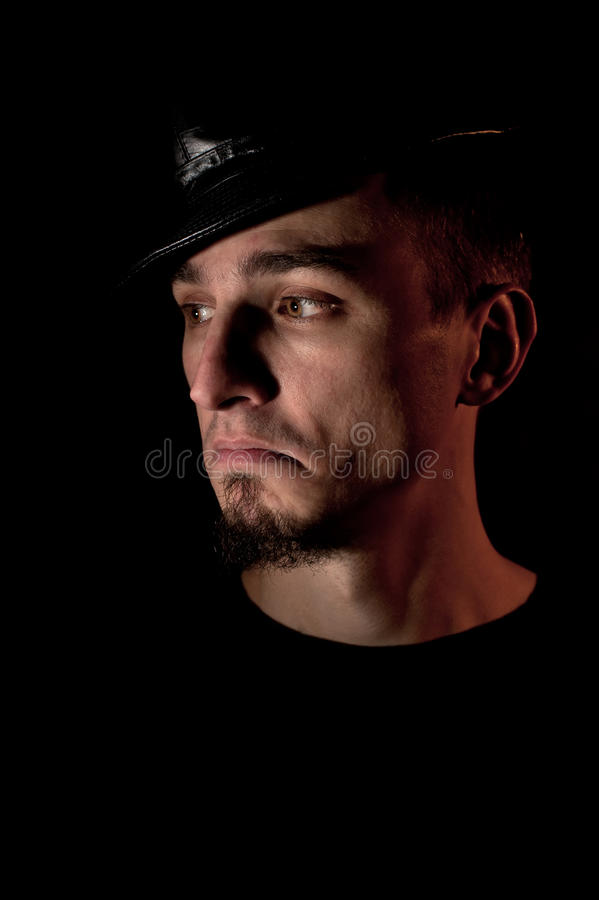 Portrait of young discontented man stock images