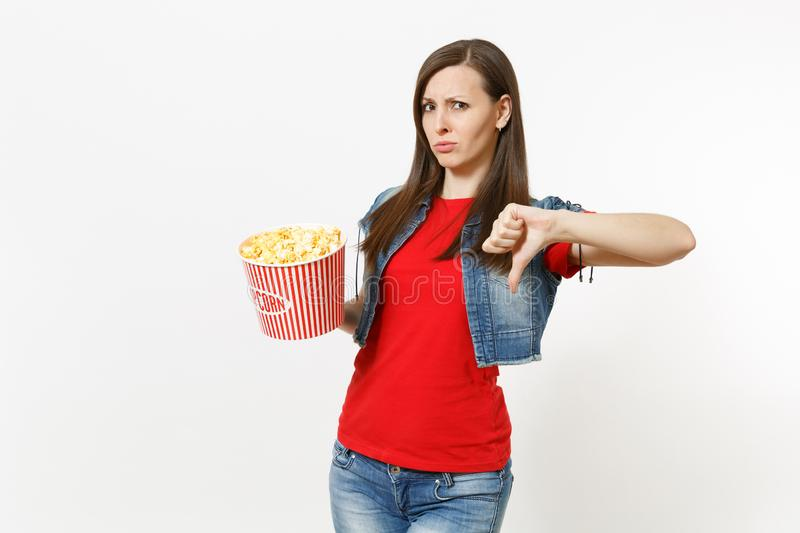 Portrait of young dissatisfied attractive brunette woman in casual clothes watching movie film, holding bucket of stock images