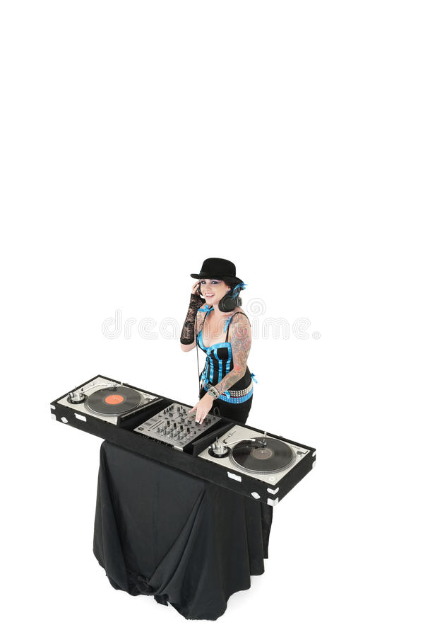 Portrait of young DJ with sound mixing equipment wearing hat over white background stock images