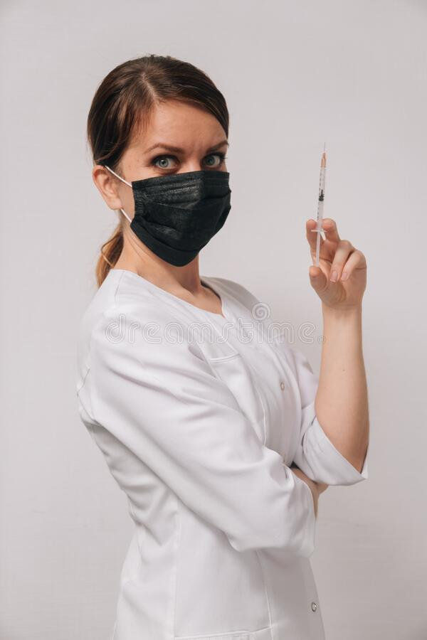 Portrait Of Woman Wearing Nurse Costume Holding Syringe