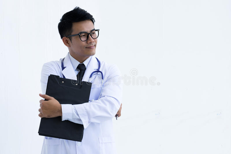 Portrait of young doctor or medic with folder and stethoscope stock photography