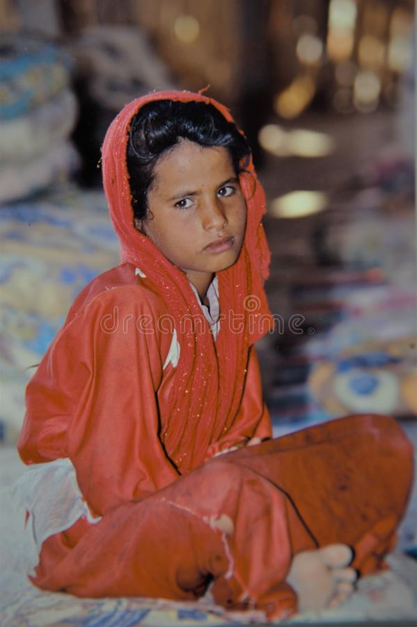 Portrait young egyptian berber child in the desert royalty free stock images