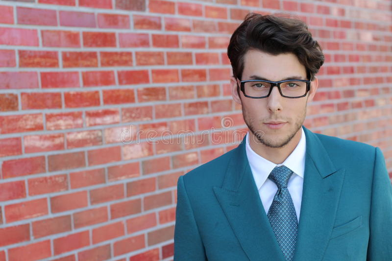 Portrait of young elegant handsome man in glasses royalty free stock photos