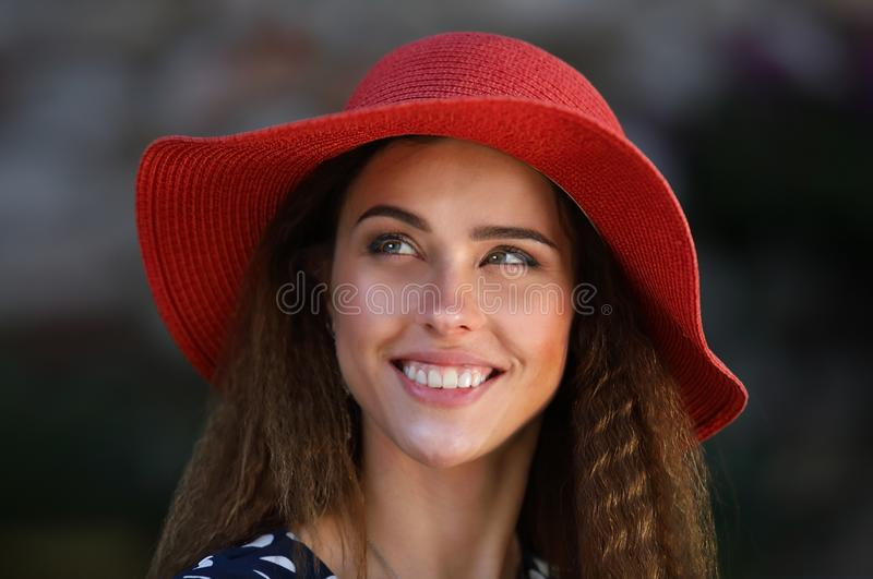 Portrait of a young elegant woman in a red hat stock photo