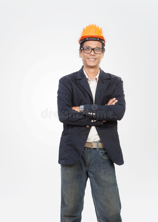portrait of young engineer man standing with smiling face isolated white background royalty free stock images