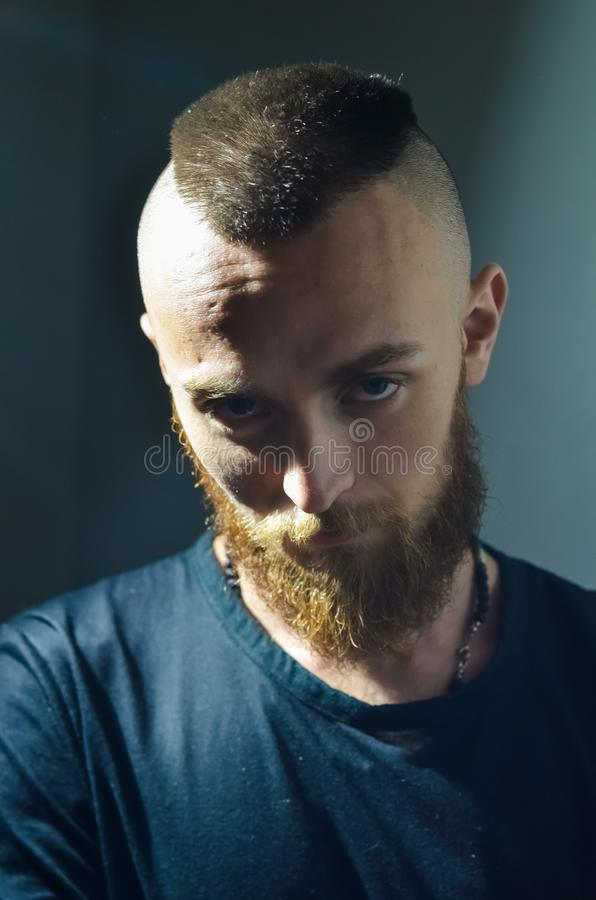 Portrait of young European hipster with fair skin and trendy ginger beard. Fashionable undercut hairstyle and handsome face featur. Es. Mohawk hairstyle stock photos