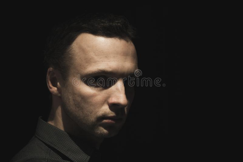 Portrait of young European man over black stock images