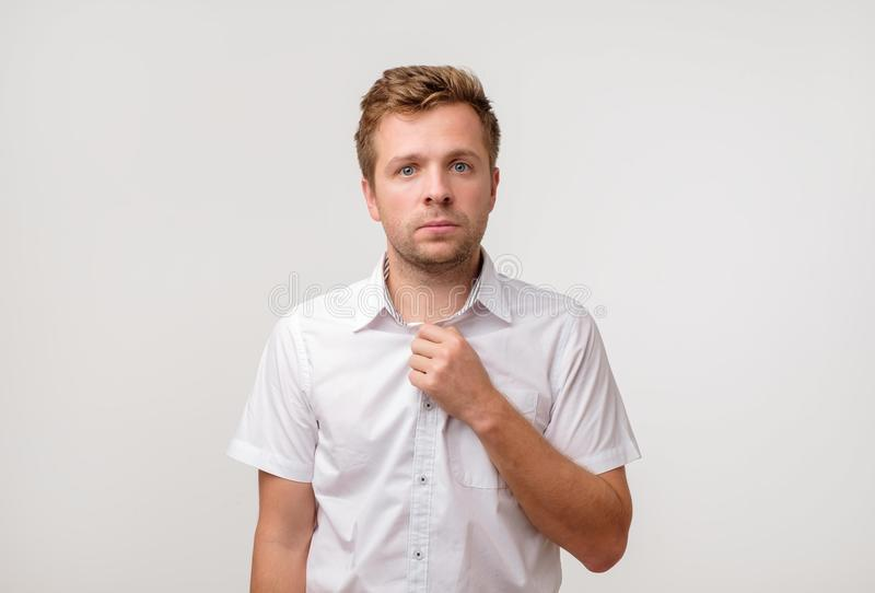 Portrait of young european man with sad face expression isolated on gray background stock images