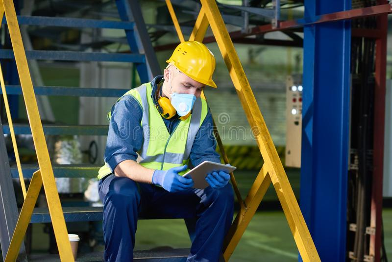 Plant Worker Using Digital Tablet stock photos