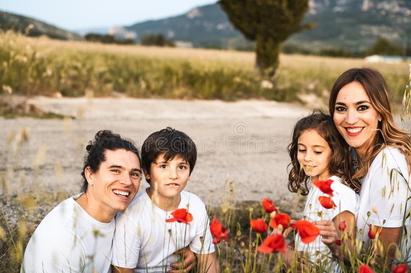 Portrait of a young family smiling and happy looking at the camera on the outside. Family having fun in the countryside stock images