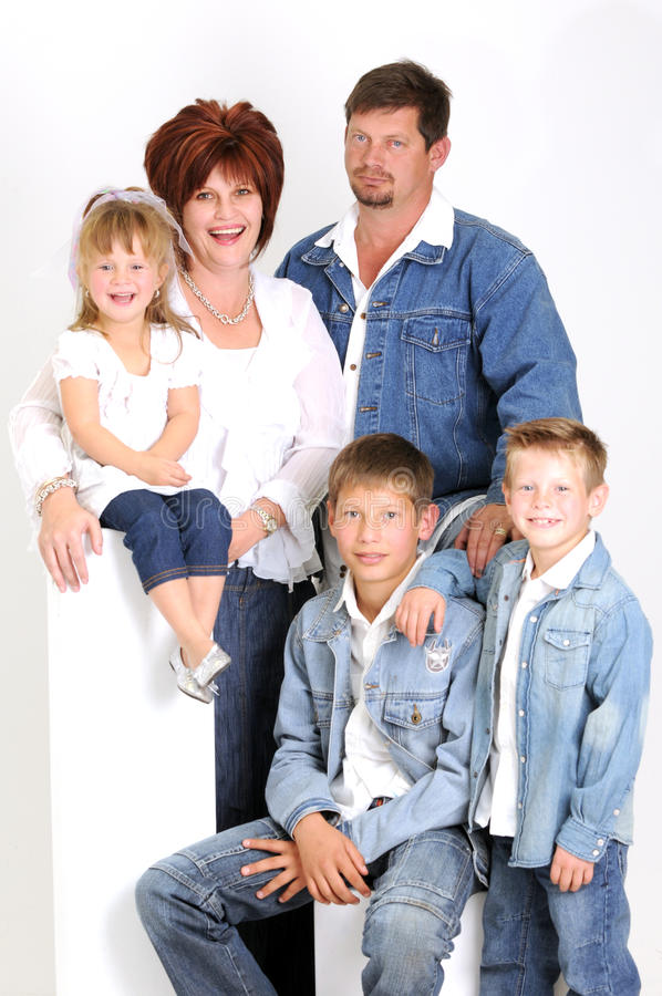 Portrait of a young family with three children stock image