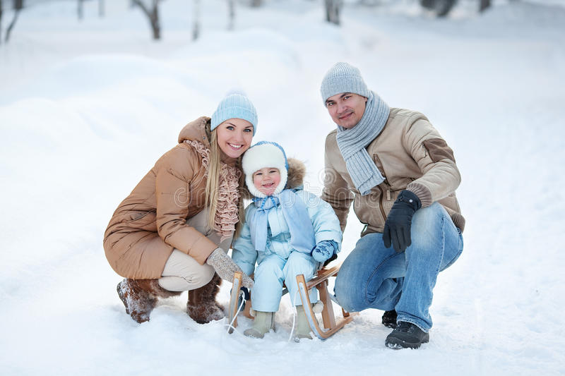 Portrait of Young family in a winter park stock image