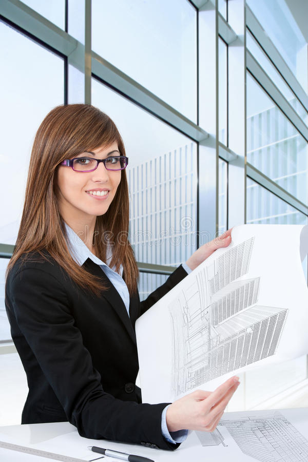 Download Portrait Of Young Female Architect With Plans. Stock Image - Image: 26593517