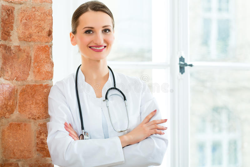 Download Portrait Of Young Female Doctor In Clinic Stock Photo - Image: 31285652