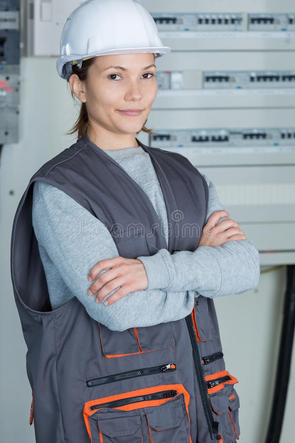 Portrait young female electrician royalty free stock image