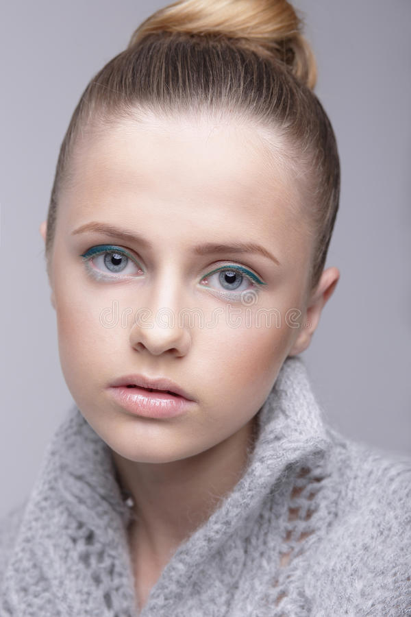 Portrait of Young Female in Grey Woolen Sweater royalty free stock photography