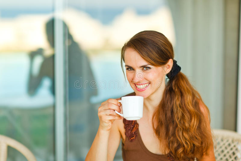Portrait of young female having cup of coffee. Portrait of female having cup of coffee royalty free stock photos