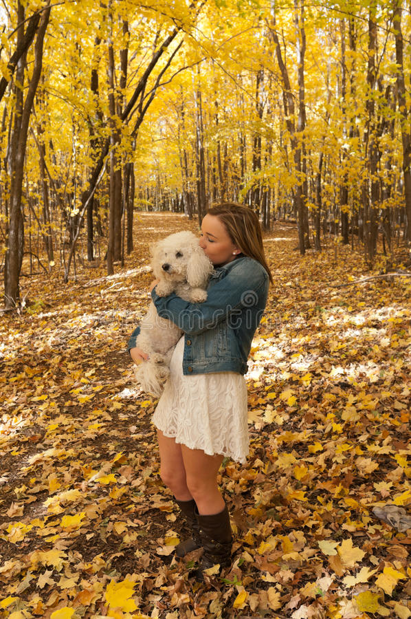 Portrait of Young Female Kissing Dog royalty free stock photography