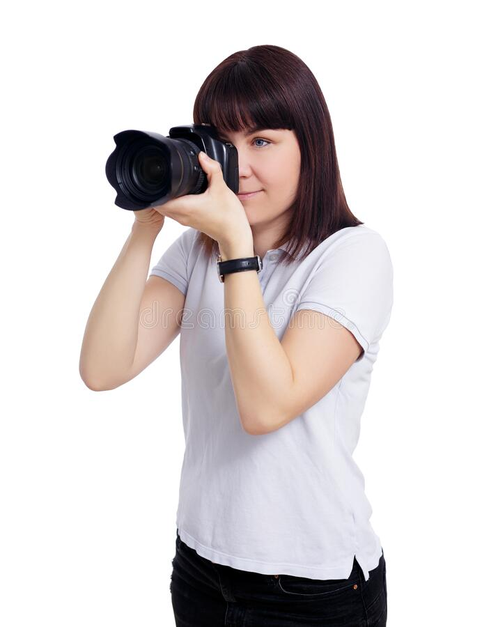 Portrait of young female photographer taking photos with modern dslr camera isolated on white royalty free stock images