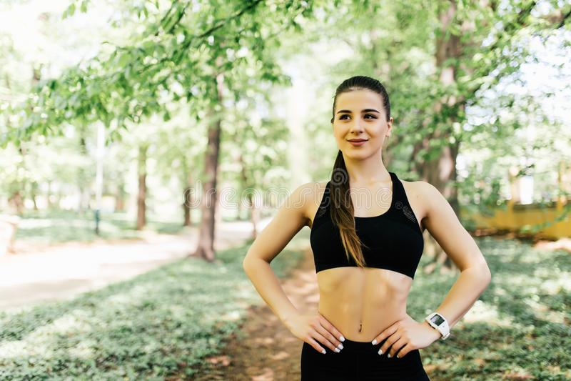 Portrait of young female before runner jogging in the city park. royalty free stock photo