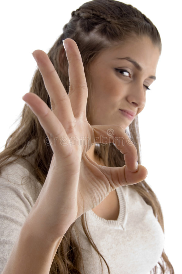 Portrait Of Young Female Showing Okay Hand Gesture Stock Photography