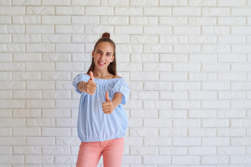 Portrait of young female showing a thumbs up stock photography