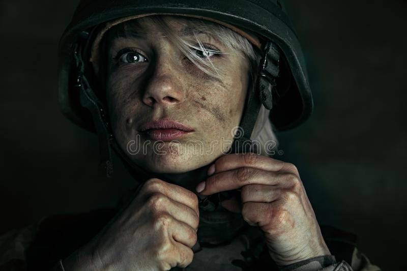 Portrait of young female soldier. Preparing for being stronger like a stone. Close up portrait of young female soldier. Woman in military uniform on the war stock images