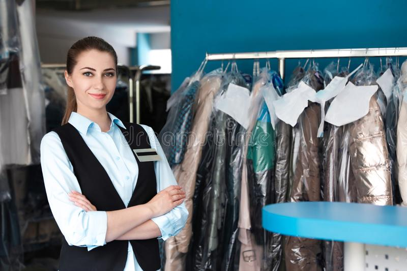 Portrait of young female worker in dry-cleaning stock photo