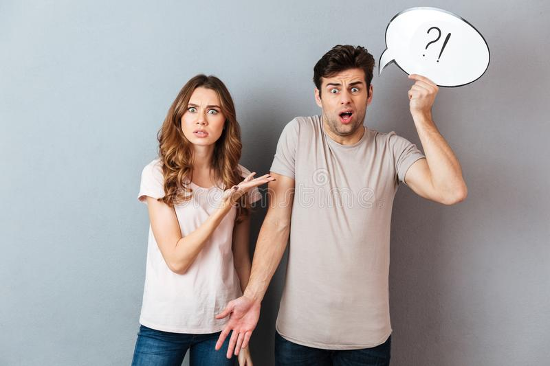 Portrait of a young frustrated couple having an argument royalty free stock image