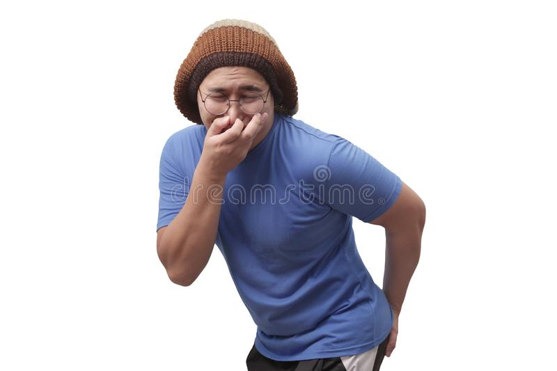 Funny Man Having Diarrhea. Portrait of young funny Asian man gesturing as if he is having stomachache isolated on white, male, pain, illness, body, health stock images