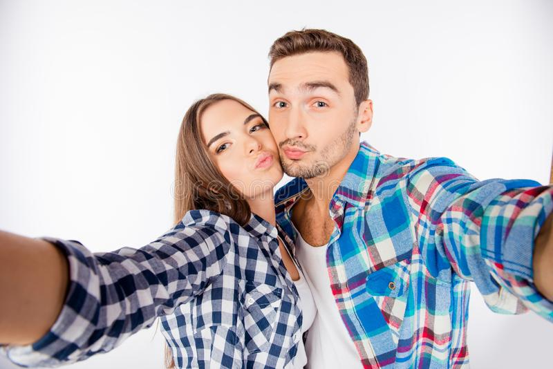 Portrait of young funny couple making selfie royalty free stock image