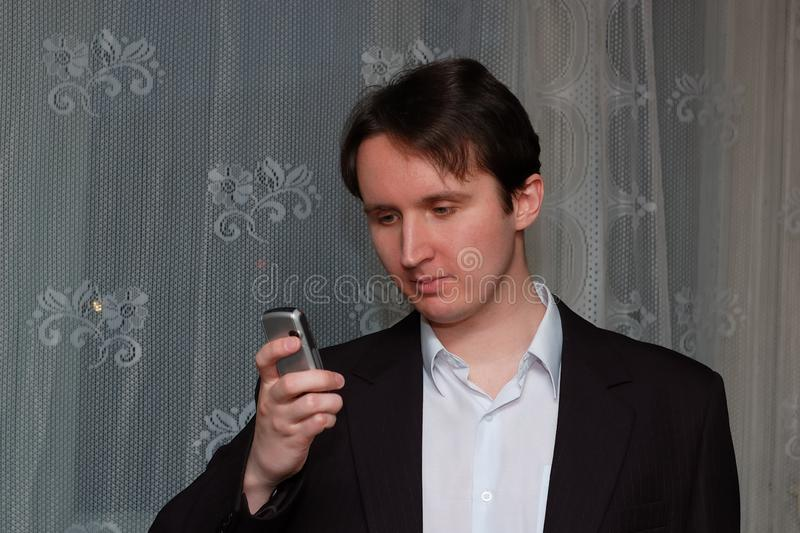 Portrait of a young funny man in jacket indoors stock photo