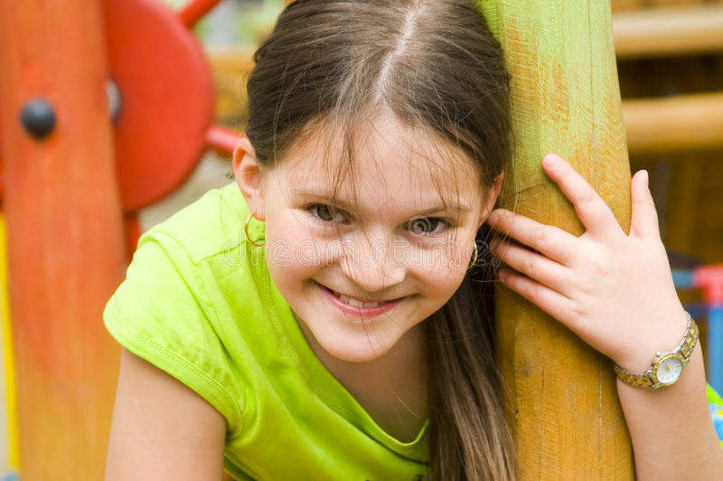A portrait of a young girl. In the garden outdoors stock image