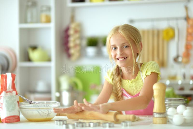 Portrait of a young girl baking in the kitchen. Portrait of young girl baking in the kitchen royalty free stock photo