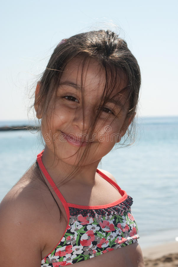young girl at the beach royalty free stock photography