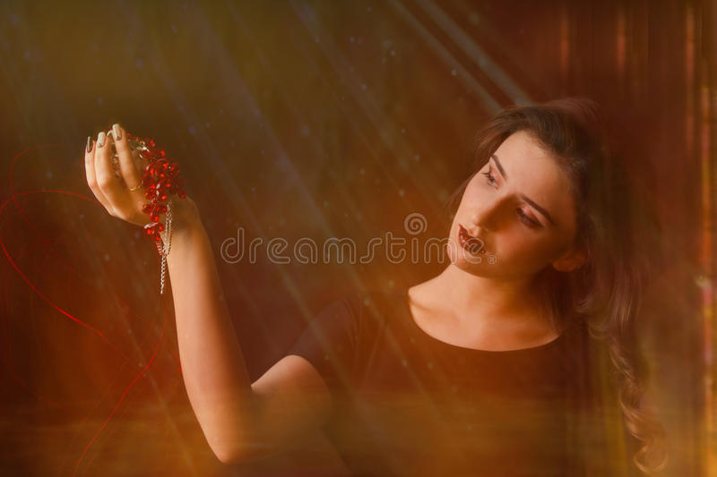 Portrait of young girl on black background stock images