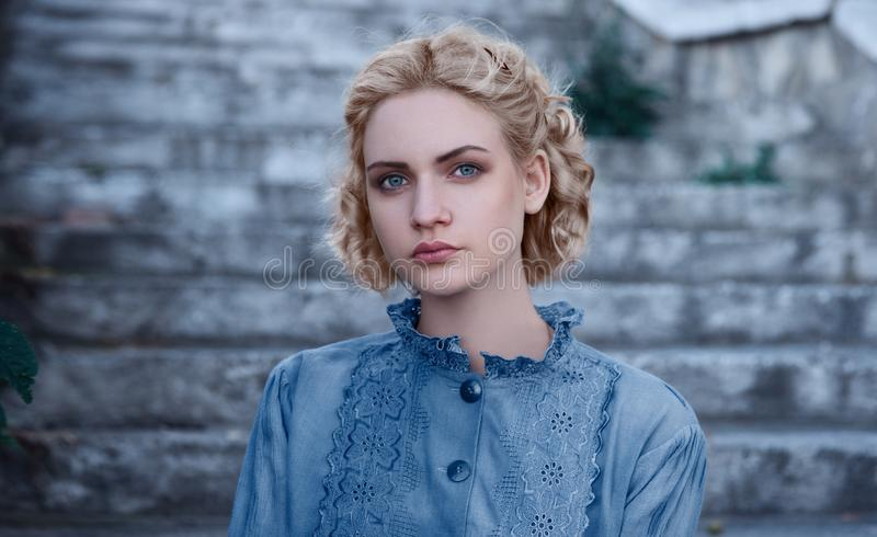 Portrait of a young girl blonde in Gothic style royalty free stock photo