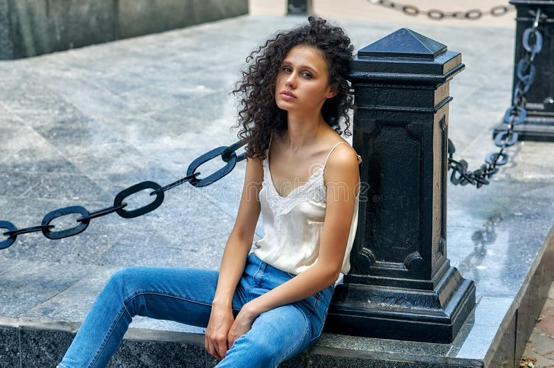Portrait of a young girl in the city . stock image