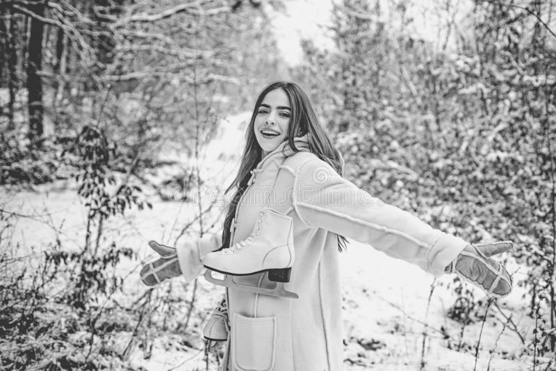 Portrait of a young girl dressed a coat. Young woman winter portrait. Sensual brunette winter girl posing and having fun royalty free stock photo
