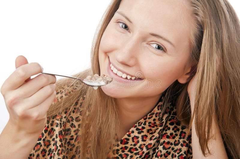 Portrait of a young girl eat flakes stock photo