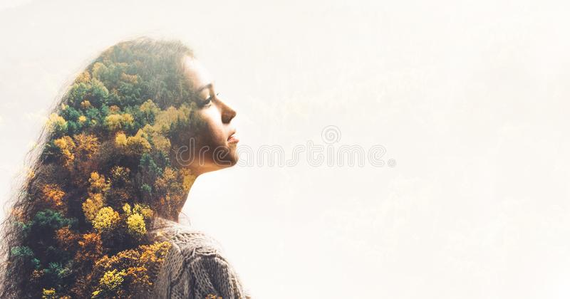 Portrait of young girl and fall forest stock image