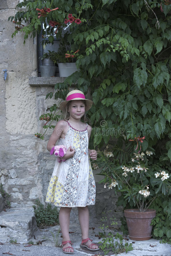Portrait of a young girl in floral dress in Provence stock photos