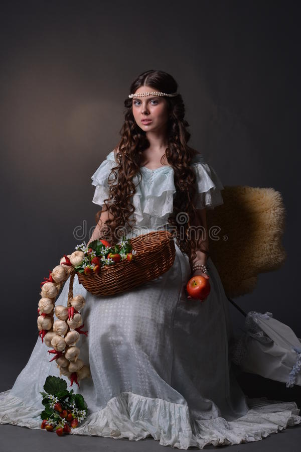 Portrait of a young girl with fruit stock photo
