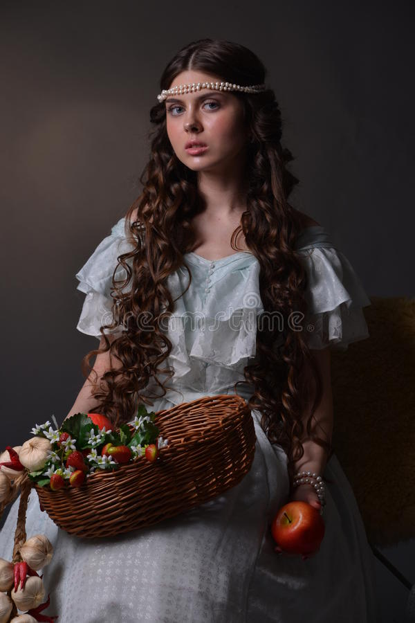 Portrait of a young girl with fruit royalty free stock photo
