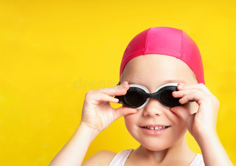 Portrait of a young girl in goggles and swimming cap. royalty free stock image