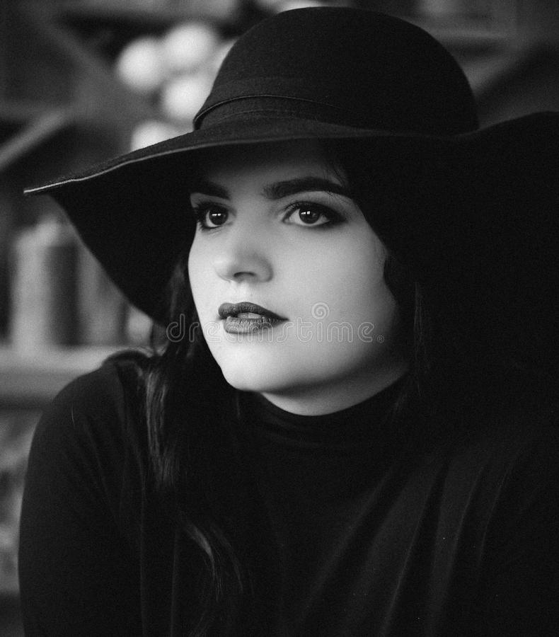 Portrait of a young girl in a hat stock images