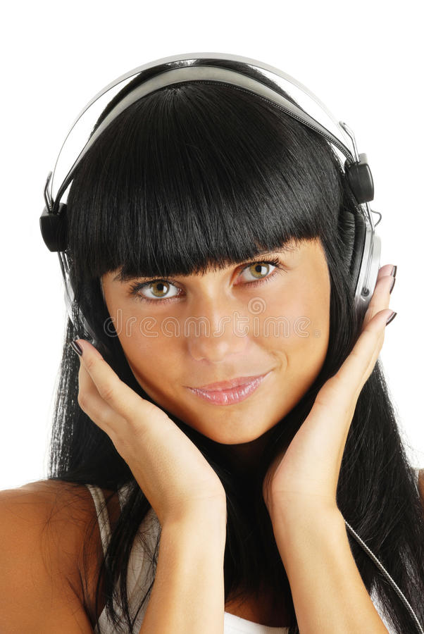 Portrait of the young girl in headphones stock images