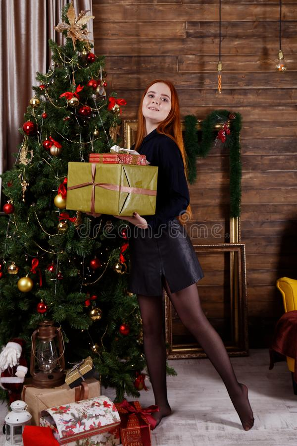 Portrait of a young girl holding a Christmas presents stock photo